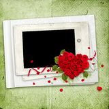 White album with red roses heart on the green Royalty Free Stock Photography