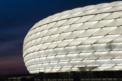 White Allianz Arena at night. Famous landmark, exterior of the Allianz Arena in Munich, Germany. Night shot, the arena lit with white light royalty free stock photo