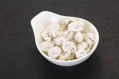 White Almond Candy. Heap in the bowl royalty free stock image