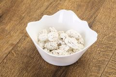 White Almond Candy. Heap in the bowl stock image