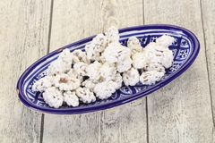 White Almond Candy. Heap in the bowl stock photography