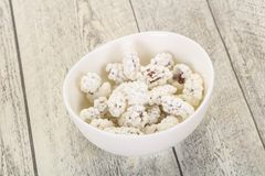 White Almond Candy. Heap in the bowl royalty free stock photo
