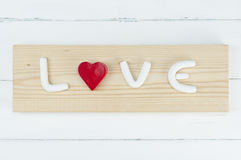 White alphabet with red heart. Love concept. Royalty Free Stock Image