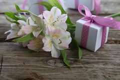 White alstroemeria and gifts Stock Photos