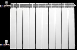 White aluminium radiator. On the black background, installed into central heating system Royalty Free Stock Photo