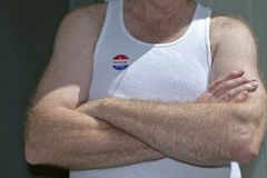 White American Man With Arms Crossed Wearing a Voter Sticker Stock Image