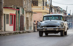 White american vintage car drives in the province Villa Clara in Cuba on the street Royalty Free Stock Photo