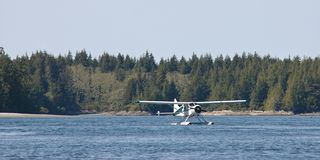 White amphibious plane on a lake Royalty Free Stock Photo