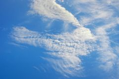 White amusing clouds on blue sky. Amazing cloud formations. White amusing clouds on blue sky royalty free stock photo