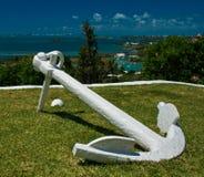 White anchor on Green Grass Stock Photo