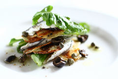 White anchovies salad with arugula, potato stock image