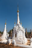 White ancient Burmese Buddhist pagodas Royalty Free Stock Images