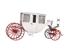 White ancient carriage with red wheels. It is isolated on a white background Royalty Free Stock Photos