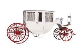 White ancient carriage with red wheels Stock Image