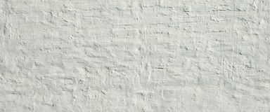 White Ancient Rough Bumpy Brick Wall Background stock photography