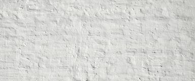 White Ancient Rough Bumpy Brick Wall Background. White Medieval Ancient Rough Bumpy Cracked Brick Wall Background Texture Royalty Free Stock Image