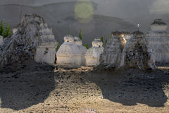 White ancient stupa at sunset near a Buddhist monastery Shay Gonpa, the Indus Valley, Ladakh, India. Royalty Free Stock Photography