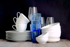 Free White And Blue Dishware Stacked On A Wooden Table Royalty Free Stock Image - 74671506