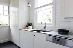 White And Charcoal New Renovated Galley Style Kitchen Royalty Free Stock Image