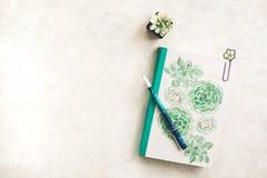 Free White And Green Journal On White Desk Royalty Free Stock Photos - 180166338