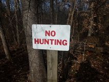 Free White And Red No Hunting Sign With Trees Stock Photos - 137940693