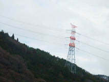 White And Red Painted Power Pole On The Mountain Forest Stock Photos