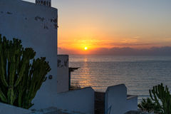 White Andalusian house. And cactus with sea view. View of the sea with sunrise in an Andalusian village stock images
