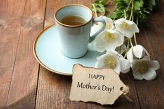 White anemone flower. Bouquet white anemone flower, cup of coffee and romantic note on wooden background. Concept mother`s day. Copy space stock photography