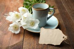 White anemone flower. Bouquet white anemone flower, cup of coffee and romantic note on wooden background. Concept mother`s day. Copy space stock photo