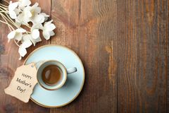 White anemone flower. Bouquet white anemone flower, cup of coffee and romantic note on wooden background. Concept mother`s day. Copy space. Top view stock photos