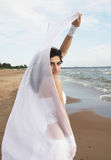White angel on the beach Royalty Free Stock Image
