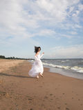 White angel on the beach Stock Images