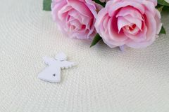 White angel. Beautiful pink flowers on white desk. royalty free stock photos
