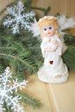 White angel. White Christmas angel near fir branches Stock Photo