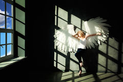 White Angel and Day Light on Background. White Angel and Day Light on Black Background Stock Photos