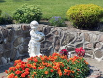 White angel in Garden, Lithuania. White angel statue in Sveksna town, Lithuania Royalty Free Stock Photo