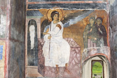 White Angel or Myrrhbearers on Christ's Grave. Is world famous fresco from the Mileseva monastery circa 1230 AD in Serbia, it depicts an angel sitting in front Stock Photo
