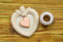 White angel photo frame with white thread and decorative heart Royalty Free Stock Images