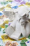 White angel sculpture on heap of euro notes Royalty Free Stock Photo