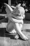White angel on a tomb. White angel in cemetery on a tomb royalty free stock photography