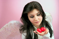 White angel with two hearts. White angel girl with two red small hearts in the hand Stock Images