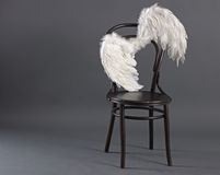 White angel wings. Hanging lonely on retro chair Stock Images