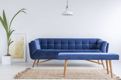 White apartment with blue sofa Royalty Free Stock Images