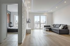 White apartment with brick wall. Bedroom and living room royalty free stock photography
