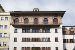 White apartment with brown shutters, Bolzano, Italy royalty free stock photography