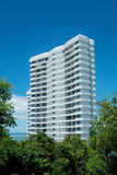 White apartment-building. In a forest, near the sea Stock Images