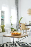 White apartment with wood table Royalty Free Stock Images