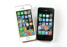 White Apple iPhone 5S & black Apple iPhone 4S Royalty Free Stock Photography