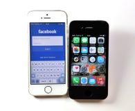 White Apple iPhone 5S & black Apple iPhone 4S Stock Photography