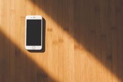 White Apple Iphone on Wooden Table Stock Photography